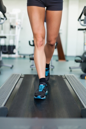 fitness woman legs on a treadmill in fitness sport club