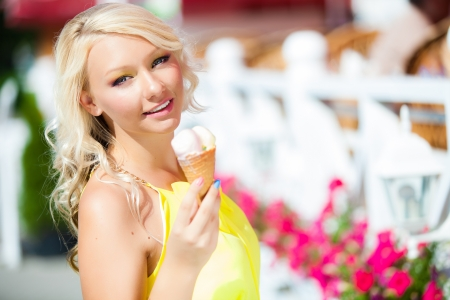 girl eating cone ice cream on summer vacation photo