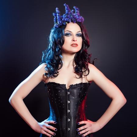 Portrait of beautiful woman wearing crown of flowers on head photo
