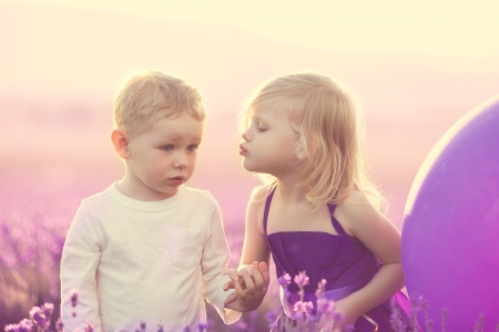 kids on lavender field at sunset, little girl kissing a boy Stock Photo - 20582353