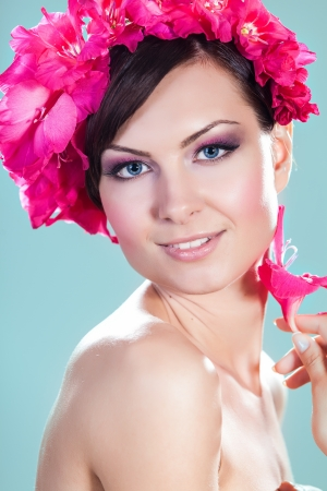 Beautiful Model Woman Face With Pink Flowers In Hair  Perfect Skin  Professional Make-up  Beauty and spa concept photo