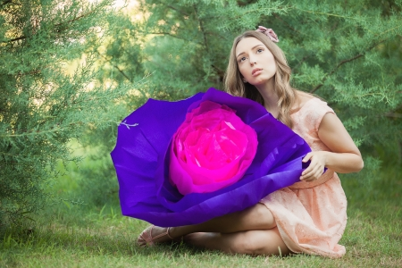 meaningless: Fancy Daydreaming Woman with a huge flower in hands. Surrealism