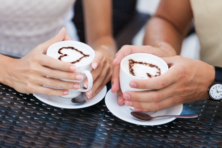 Happy couple in love drinking coffee photo