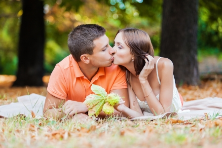 Happy young couple in love at the autumn park photo