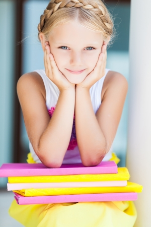 Education - funny girl with a stack of books Stock Photo - 22354250