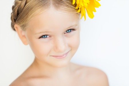portrait of cute little girl over white background in summer day Stock Photo - 22354255
