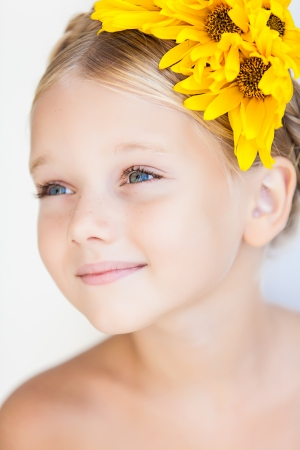 portrait of cute little girl over white background in summer day photo