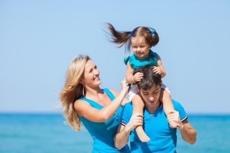 Family on beach vacation photo