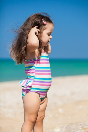 little girl have a good time at the beach photo