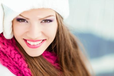 woolly: Portrait of smiling woman wearing woolen accessories