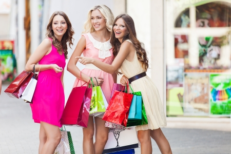 Three beautiful girlfriends with with Shopping Bags photo