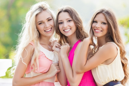 teenage girl dress: Portrait of a group of beautiful young female friends laughing