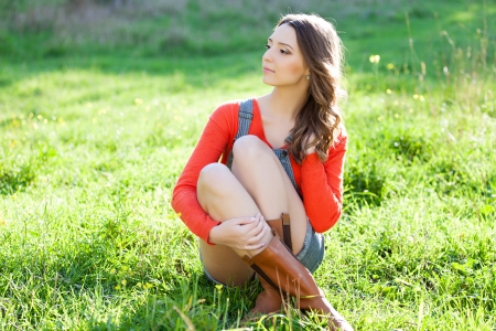 portrait of beautiful young woman in sun rays photo
