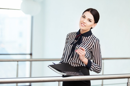 Portrait of business woman with paper folder photo