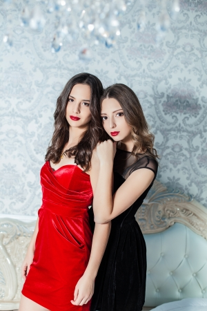 Portrait of fashionable young girls in cocktail dresses Stock Photo - 23239214