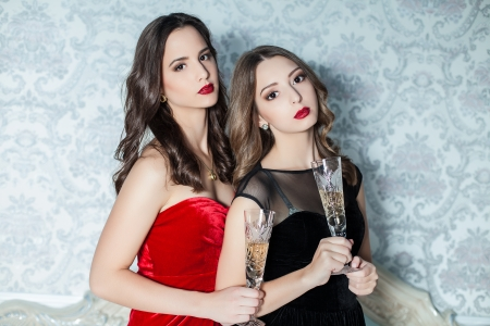 Portrait of elegant young womans with a champagne glasses at celebration photo