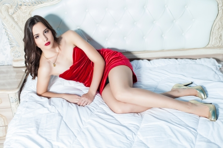 Fashion portrait of elegant young woman in a luxurious interior photo