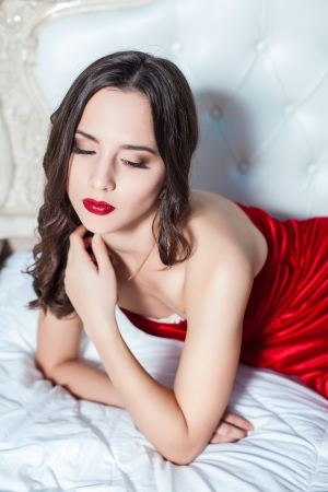 Fashion portrait of elegant young woman in a luxuus inter Stock Photo - 23239612
