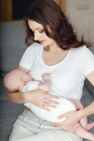 loving young mother breastfeeding her baby