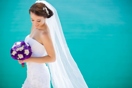 Beautiful bride outdoors photo