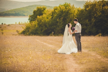 young wedding couple portrait on a meadow, summer nature outdoor