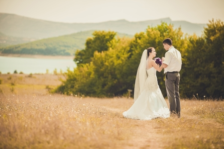 young wedding couple portrait on a meadow, summer nature outdoor Stock Photo - 23683128