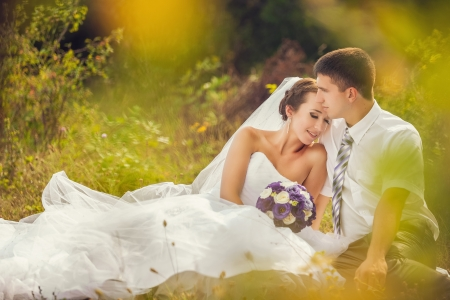 young wedding couple portrait on a meadow, summer nature outdoor photo