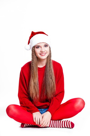 christmas, new year, winter concept - Smiling happy girl on white background. photo