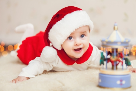 Cute baby in suit of Santas little helper