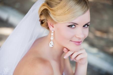 veils: Beautiful bride outdoors - soft focus
