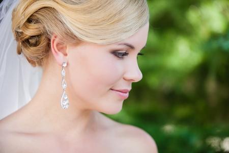 bridal makeup: Beautiful bride outdoors - soft focus