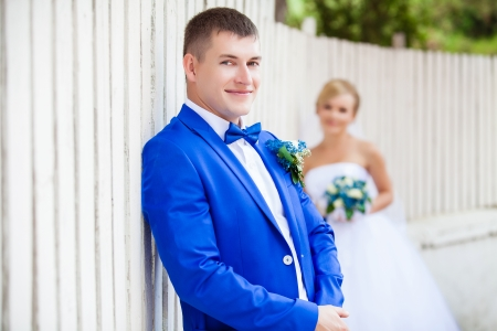 wedding pair at the wooden white fence photo