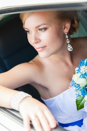 wedding portrait of bride in car photo