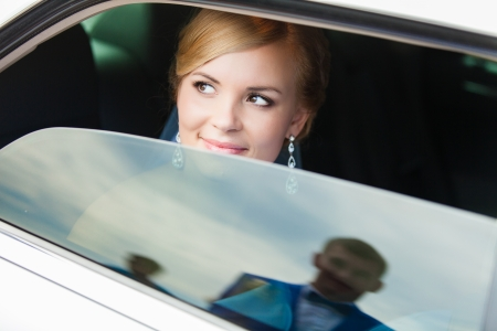 wedding portrait of bride in car
