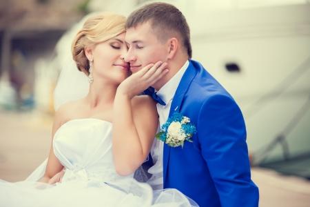 Beautiful bride and groom wedding couple near sea yacht photo