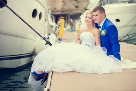 Beautiful bride and groom wedding couple near sea yacht