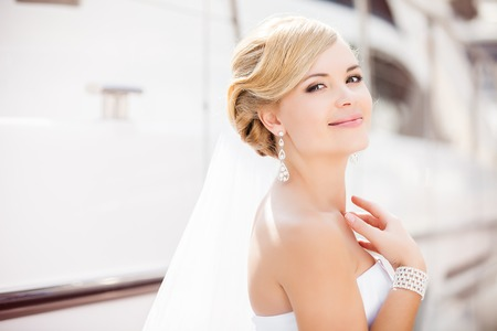 beautiful blonde girl with green eyes: Beautiful bride outdoors - soft focus