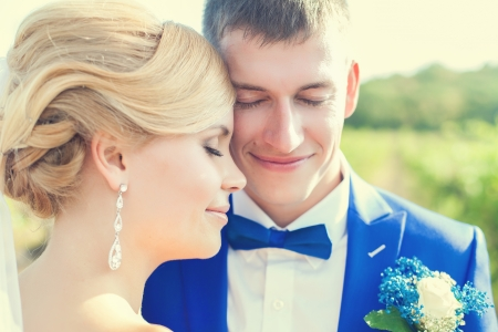 Wedding couple in summer nature close-up portrait photo