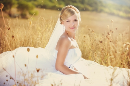Beautiful bride outdoors, summer day photo