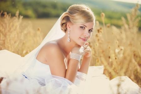 bridal makeup: Beautiful bride outdoors, summer day