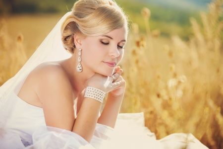 Beautiful bride outdoors, summer day