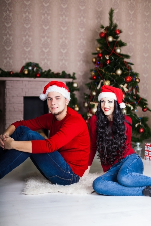 Christmas Couple.Happy Smiling Family at home celebrating. New year photo