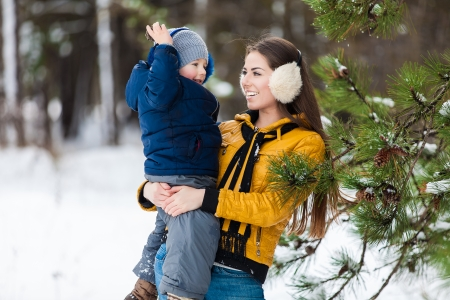 Mother and son enjoying beautiful winter day photo