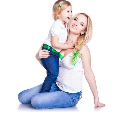 closeup portrait of young mother hug her little daughter, studio shot, happy family photo