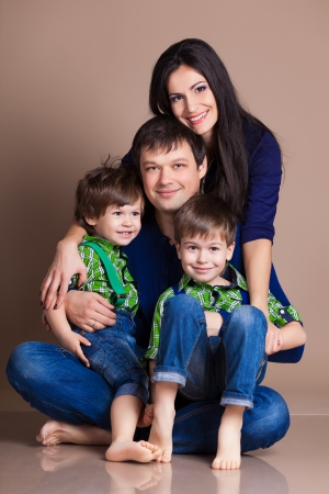 Portrait of happy fun beautiful family with two children photo