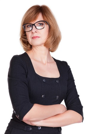 Closeup portrait of attractive mature female lawyer standing with hands folded isolated over white background Standard-Bild