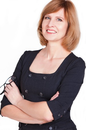 Portrait of a mature businesswoman smiling at the camera isolated on a white background photo