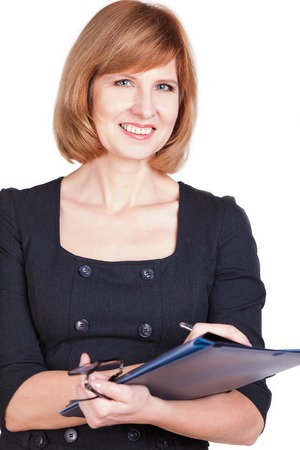 Portrait of a smiling businesswoman holding paperwork isolated on a white background.