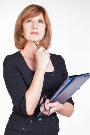 Portrait of thoughtful business woman writer daydreaming. Isolated on white background. Imagens