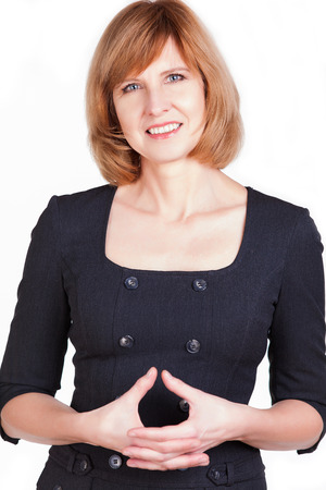 Portrait of a mature businesswoman smiling at the camera isolated on a white background Stock Photo